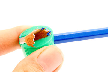 Hand and sharpener in close up