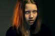 Angry teen girl in hood
