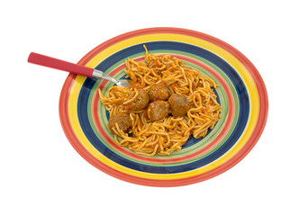 Spaghetti and meatball dinner on dish with fork