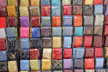 neckties display on stand on San Lorenzo market in Florence