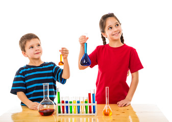 Two kids with chemical flask