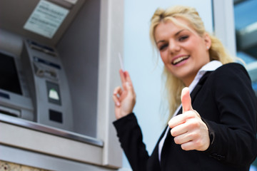 Smiling woman with credit card