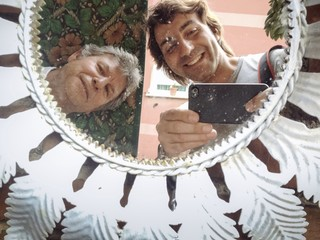man taking photo at mirror