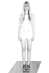 Overexposed file photo of young woman, in full length