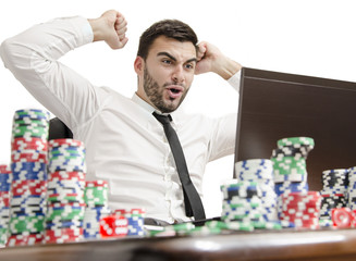 Businessman playing online poker win