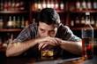 alcoholic drunk man thinking on alcohol addiction at pub bar