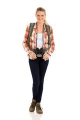 female tourist holding binoculars