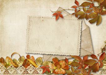 Vintage background with old card and autumn decor