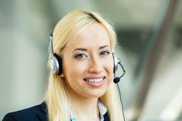 Female customer service representative using hands free device
