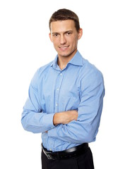 Portrait of young smiling man in blue shirt