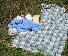 Summer fun, - dress, underwear & sun lotion.