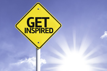 Get Inspired road sign with sun background