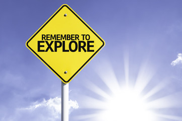 Remember to Explore road sign with sun background
