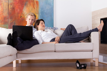 Business couple resting at home