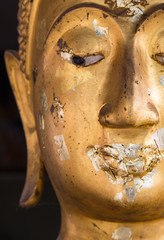Close Up half face of a buddha