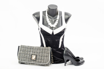 Black and white dress on mannequin with matching accessories