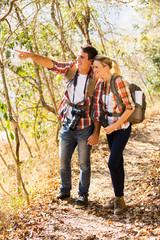 young couple mountain climbing