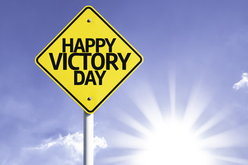 Happy Victory Day road sign with sun background