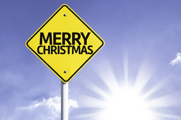 Merry Christmas road sign with sun background