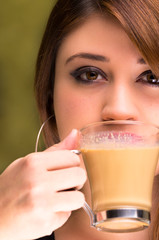 closeup of a beautiful girl drinking coffee