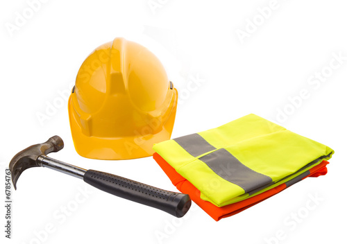 Yellow hard hat, a hammer and orange and yellow reflective vest  - 67854763