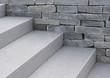 Leinwandbild Motiv Moderne Natursteintreppe und Natursteinmauer in grau