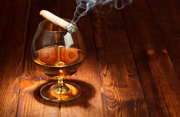 Whiskey and smoking cigar