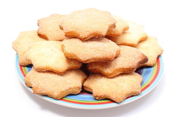 Fresh homemade cookies on colorful plate. White background