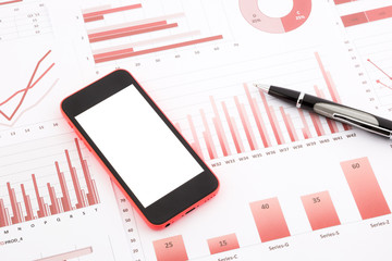 blank mobile phone  on red graphs, charts , data and business re