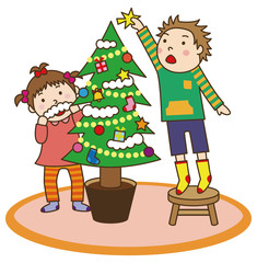 クリスマスツリーを飾る子供たち