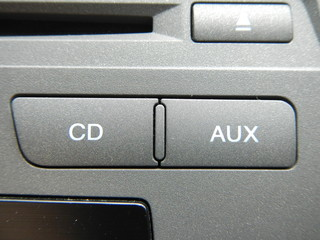 CD and AUX button
