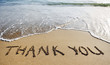 thank you word drawn on the beach sand - 67857378