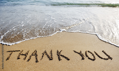 Fotobehang Zee / Oceaan thank you word drawn on the beach sand