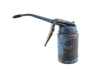 Close up of an old, blue, rusty oil can