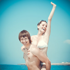 Young couple is having fun on the beach