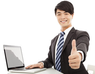 young business man thumb up with laptop