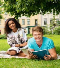 Multi ethnic students couple preparing for final exams