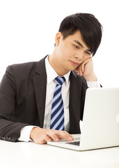 young business man feel tired or angry with laptop