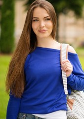 Beautiful young girl in a city park on summer day