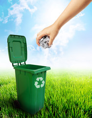 Green plastic trash recycling container ecology concept.