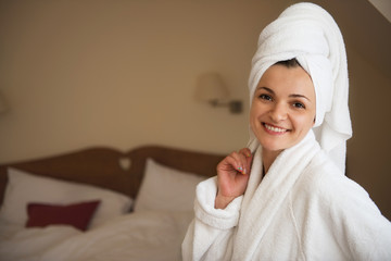 Beautiful young woman in bathrobe