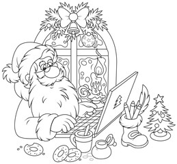 Santa Claus checking his Christmas email