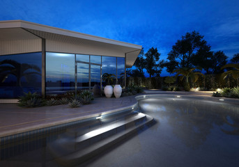 Luxury villa at night with an illuminated pool
