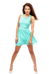 beautiful young slim brunette woman wearing a blue dress isolate