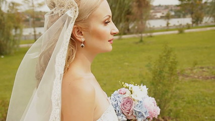 The bride goes along the green hills