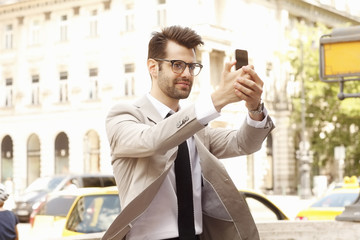 Businessman taking selfie