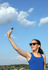 girl make selfie on a smart phone