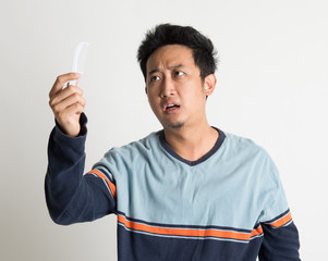Man checking on a comb with shock face