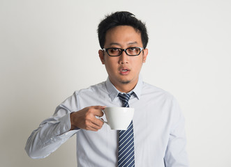 Tired Asian businessman drink coffee