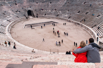 Roman amphitheater with a couple in the foreground